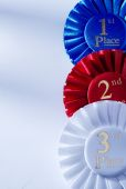 Set of three winners rosettes and ribbons — Stock Photo