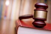 Judges gavel resting on a law book — Stock Photo