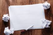 Blank Papers and Pen with Crumpled Papers on Sides — Stock Photo