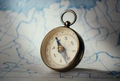 Magnetic compass standing on map — Stock Photo