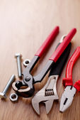 Bolts and nuts with a set of plumbing tools — Foto de Stock