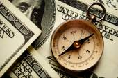 Magnetic compass on US dollar notes — Stock Photo