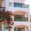 Facade of Hotel with balconies and windows decorated with flowers , Egypt — Stock Photo #72470803