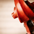 Close Up of Violin Scroll in front of Sheet Music — Stock Photo #76182677