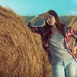 Girl next to haystack — Stock Photo #57675479