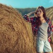Girl next to haystack — Stock Photo #57676245