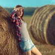 Girl next to haystack — Stock Photo #57676469