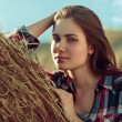 Girl next to haystack — Stock Photo #57677491