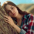 Girl rests against haystack — Stock Photo #57677717