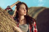 Girl next to haystack — Stock Photo