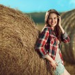 Girl next to haystack — Stock Photo #57684061