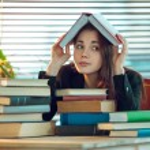 Girl among books — Stock Photo #60763501