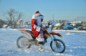 Santa Claus astride on the motocross bike — Foto Stock