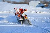Santa Claus riding on a motorcycle turning MX — Stock Photo