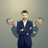 Men behind confident businessman — Stock Photo