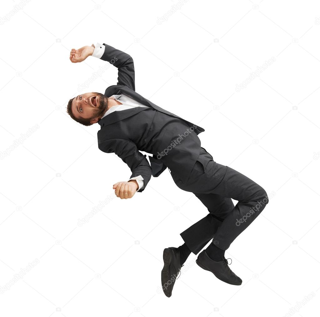 Frightened Businessman Falling Down Stock Photo