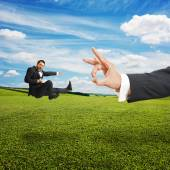 Man kicking and flying at big flick — Stock Photo