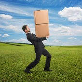 Man carrying two heavy boxes — Stock Photo
