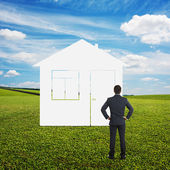 Man looking at imaginary house — Stock Photo