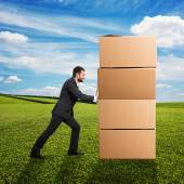 Man moving boxes — Stock Photo