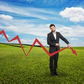 Sad broker with falling down graph — Stock Photo
