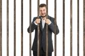 Businessman behind the prison cell — Stock Photo