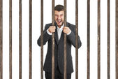 Man behind the prison cell over white — Stock Photo