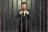 Man behind the prison cell — Stock Photo