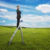 Pleased businessman standing — Stock Photo