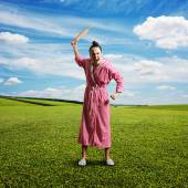 Discontented screaming housewife — Stock Photo