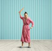 Screaming housewife with rolling pin — Stock Photo