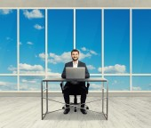 Smiley businessman in light office — Stock Photo