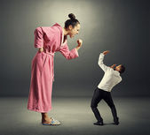 Woman and small man — Stock Photo