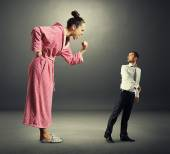Woman shouting at small scared man — Stock Photo