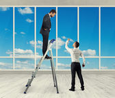 Man standing on stepladder and looking — Stock Photo