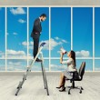 Woman with megaphone sitting on chair — Stock Photo #62739987