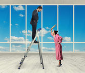 Dissatisfied man standing on stepladder — Stock Photo