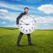 Excited businessman holding big white clock — Stock Photo #64253599