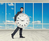 Man with clock looking at camera — Foto de Stock
