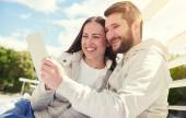 Couple looking at tablet pc — Stock Photo