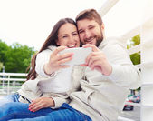 Photo of smiley young couple — Stock Photo