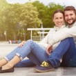 Couple sitting and looking at camera — Stock Photo #74201269