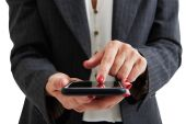 Woman in formal wear holding smartphone — Stock Photo