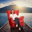 Woman on the red chair on moorage — Stock Photo #77065009