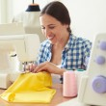 Woman working on sewing machine — Stock Photo #77065325