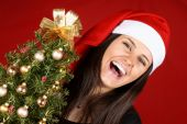 Santa Claus girl laughing — Stock Photo