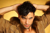 Portrait of a caucasian young man with fur — Stock Photo