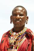 Young massai warrior man posing on bright sunny beach in Kenya — Stock Photo