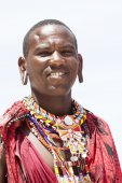 Young massai warrior man posing on bright sunny beach in Kenya — Stock Photo