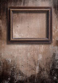 Frame on a old wall — Stockfoto